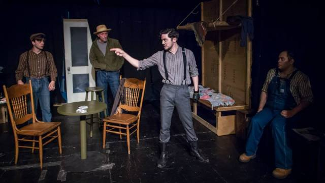 Brad Walker in the foreground with Will Rose, Gavin Sakae McLean and Anthony Phillips in a scene from Of Mice And Men.